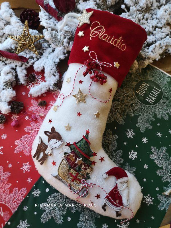 Babbo Natale con slitta e cerbiatto